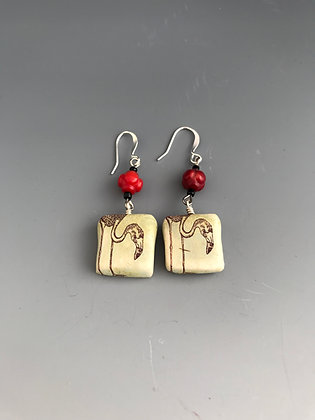 flamingo earrings with red bead