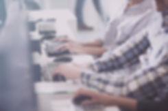 A help desk employee entering data.