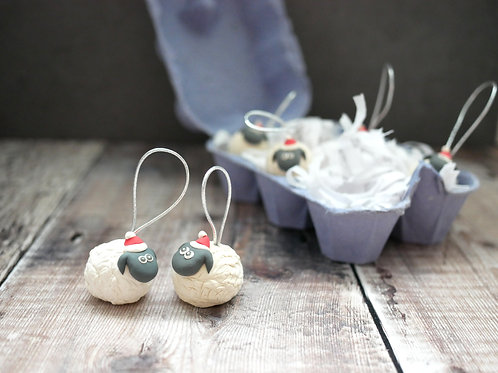 Handmade white sheep christmas tree decorations created by Silverpasta Crafts with plastic free egg box packaging
