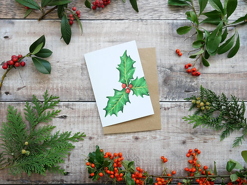 Illustrated festive holly Christmas card made from recycled paper and eco friendly plastic-free wrapper
