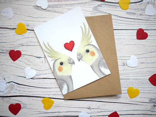 Illustrated valentine's day card featuring two cockatiels and a heart by Silverpasta Crafts