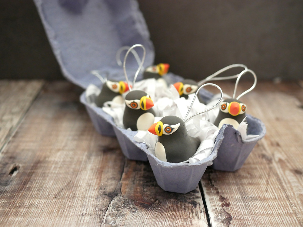 Handmade Christmas Puffin Decorations in an egg box