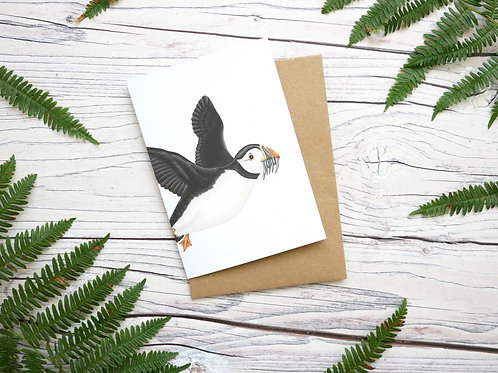 Illustrated flying puffin greetings card made from 100% recycled card and plastic-free wrapper
