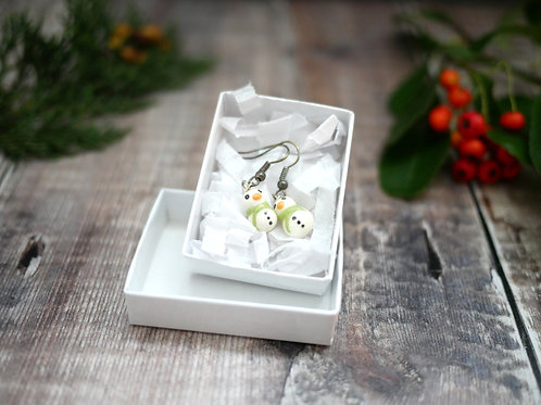 Tiny handmade snowman earrings in a white recycled box