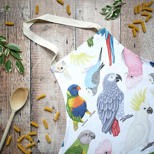Cotton apron featuring parrot illustrations designed by Silverpasta Crafts