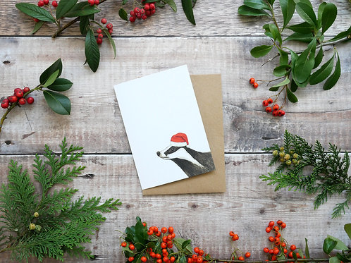 Illustrated badger wearing santa hat Christmas card made from recycled paper and eco friendly plastic-free wrapper