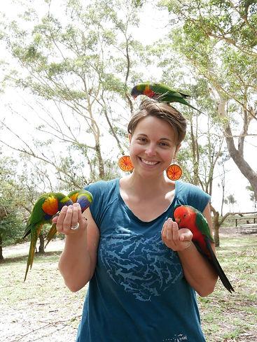 Jess Smith lady feeding rainbow lorikeet parrots