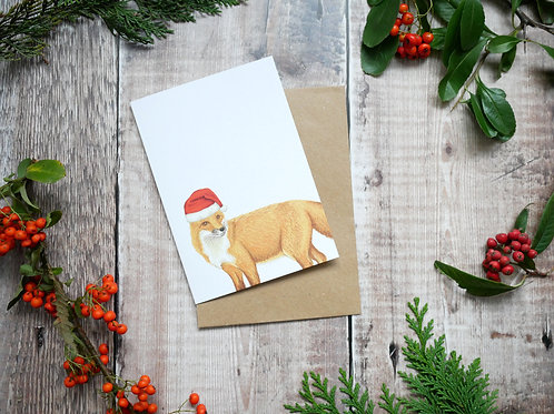 Festive fox wearing a christmas hat on a recycled card with a brown kraft envelope