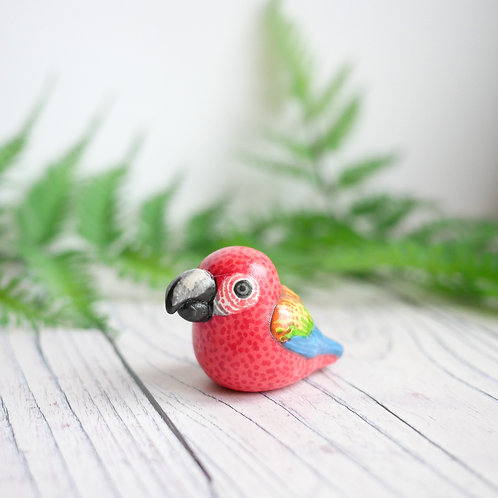 Small handmade scarlet macaw bird totem ornament made from air dry clay