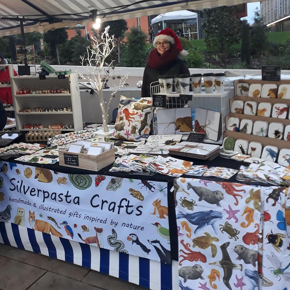 Silverpasta Crafts artist at an outdoor Christmas market stall