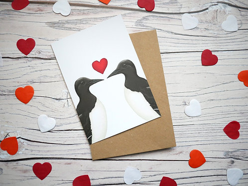 Illustrated valentine's day card featuring two guillemots and a red heart by Silverpasta Crafts