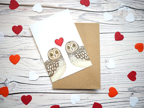 Illustrated valentine's day card featuring two short eared owls with a red heart by Silverpasta Crafts