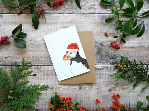 Illustrated puffin wearing santa hat Christmas card made from recycled paper and eco friendly plastic-free wrapper