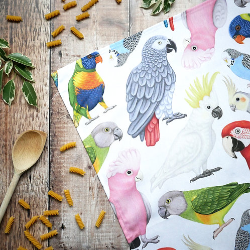Cotton apron featuring parrot illustrations by Silverpasta Crafts