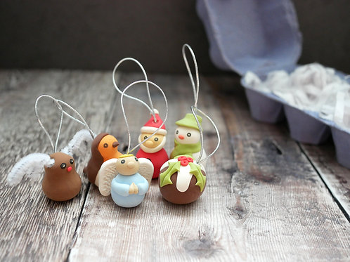Silverpasta handmade Christmas tree decorations with reindeer angel robin santa snowman pudding and eco friendly packaging