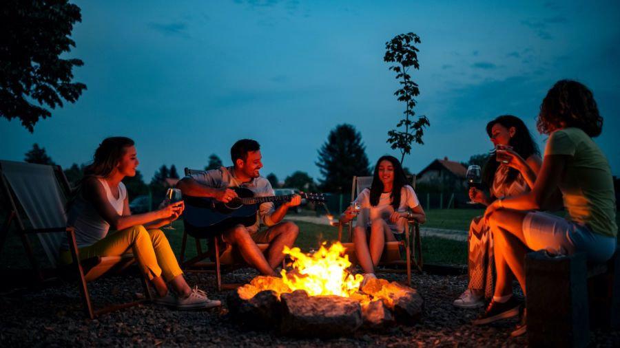 people-singing-around-a-campfire-900x506.jpeg