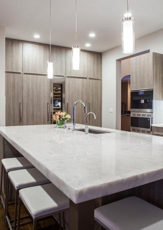 quartzite kitchen island and fridge wall