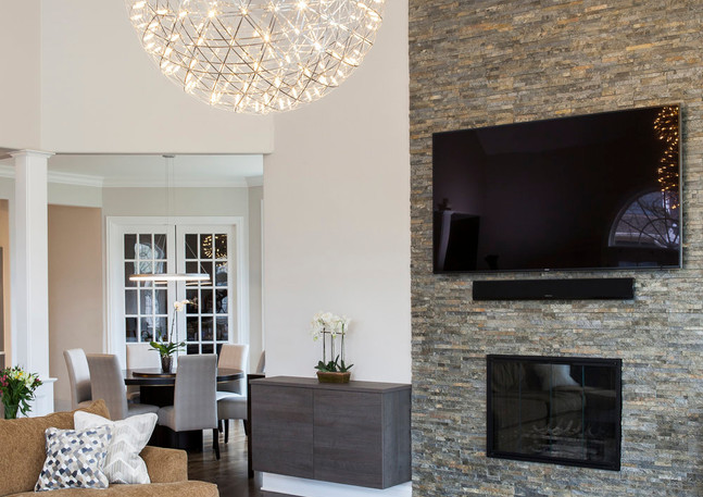 smi family room fp wall with lights afte