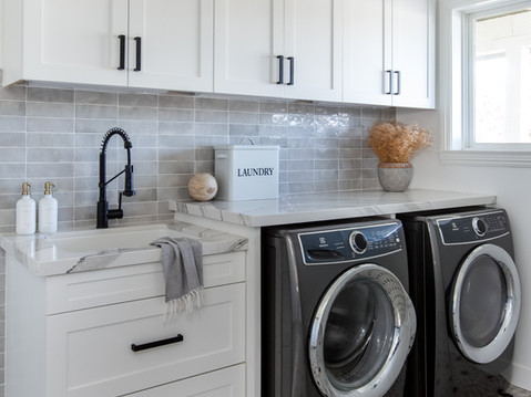 Modern black and white laundry room by Temecula, California based staging and interior designer Laura Lochrin Interiors.