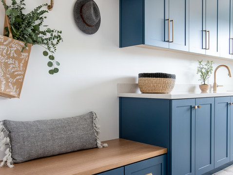 Modern laundry room with blue cabinets by Temecula, California based staging and interior designer Laura Lochrin Interiors.