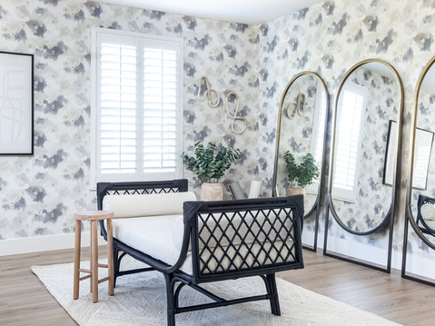 Floral black and white wallpaper in bedroom by Temecula, California based staging and interior designer Laura Lochrin Interiors.