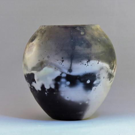 Pit fired porcelain spherical form 13cm x 12cm