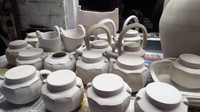 Faceted jars and teapots awaiting bisque firing