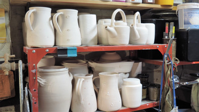 Jugs, teapots, ginger jars and lasagne dishes waiting to be glazed