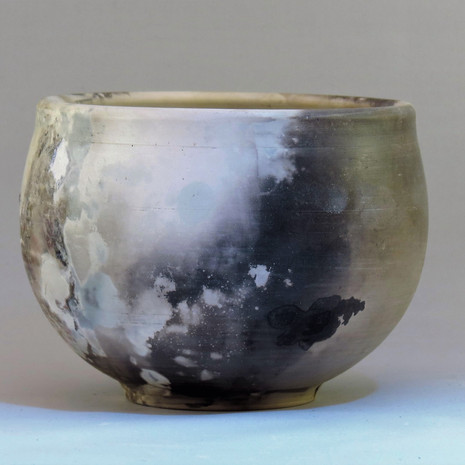 Pit fired small porcelain bowl 14cm x 10cm