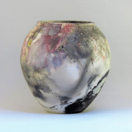 Pit fired spherical form with copper detail