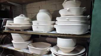 A selection of pots waiting to be glazed - lasagne dishes, plates, bowls