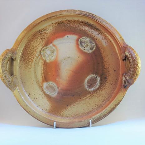 Wood fired saltglazed platter with shell design 30cms dia