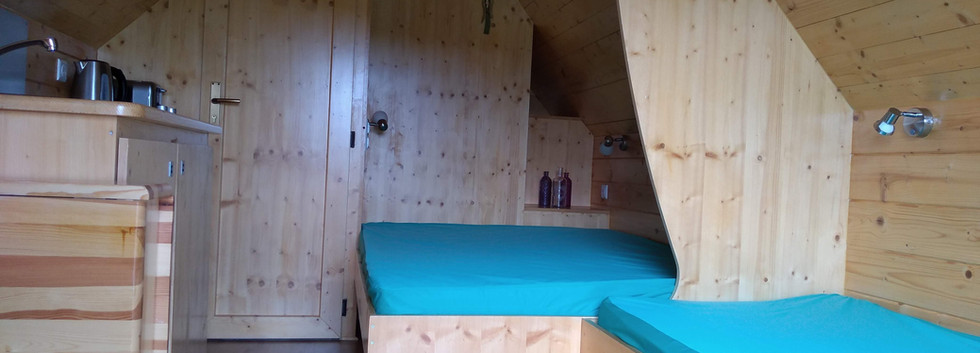 Double Bed and Single Bed with Pull Out Bed Under.