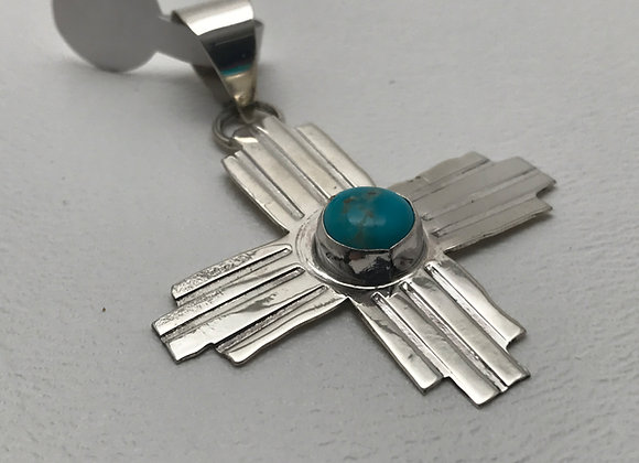 Turquoise set in Sterling Silver Zia Symbol Pendant