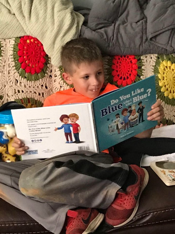 Reading the book he chose!