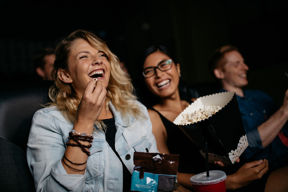 people laughing at the movies
