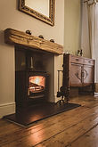 Wood burning stove fireplace with oak ma