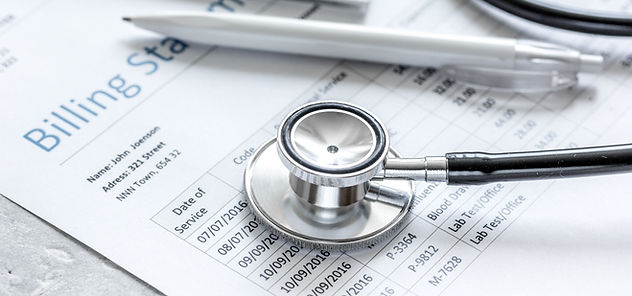 stethoscope and billing documents