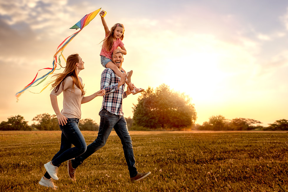 family running through field letting kit