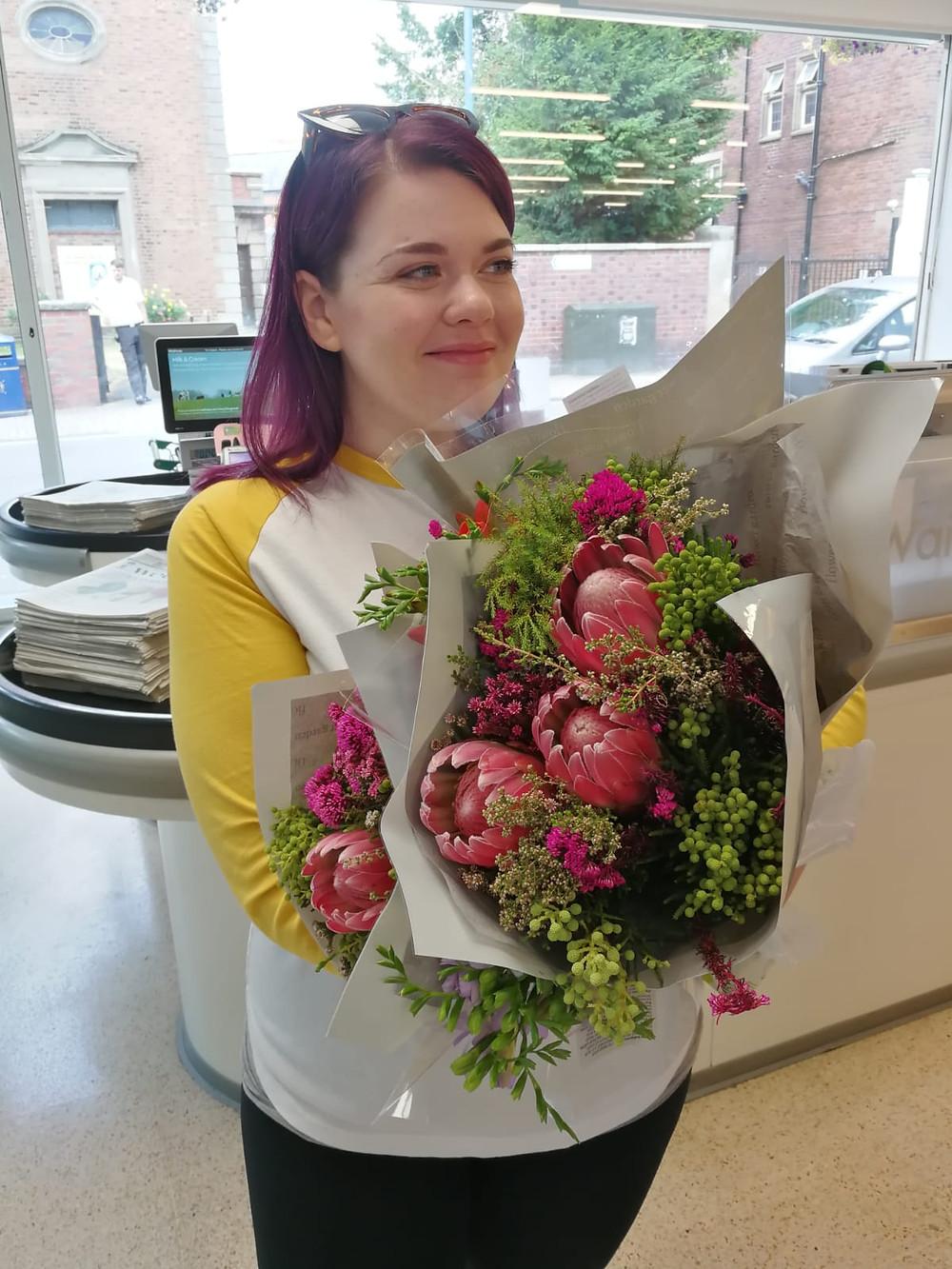 Holding my Waitrose wedding flowers ready for my DIY wedding bouquet