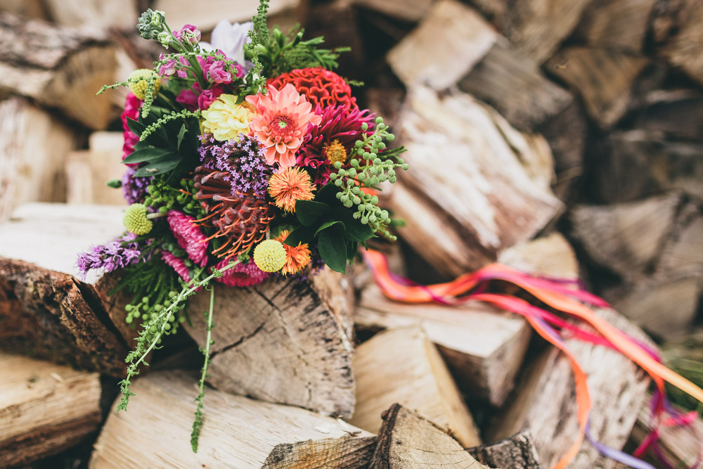 My DIY wedding flowers sitting ontop of a rustic wood pile and the royal forester