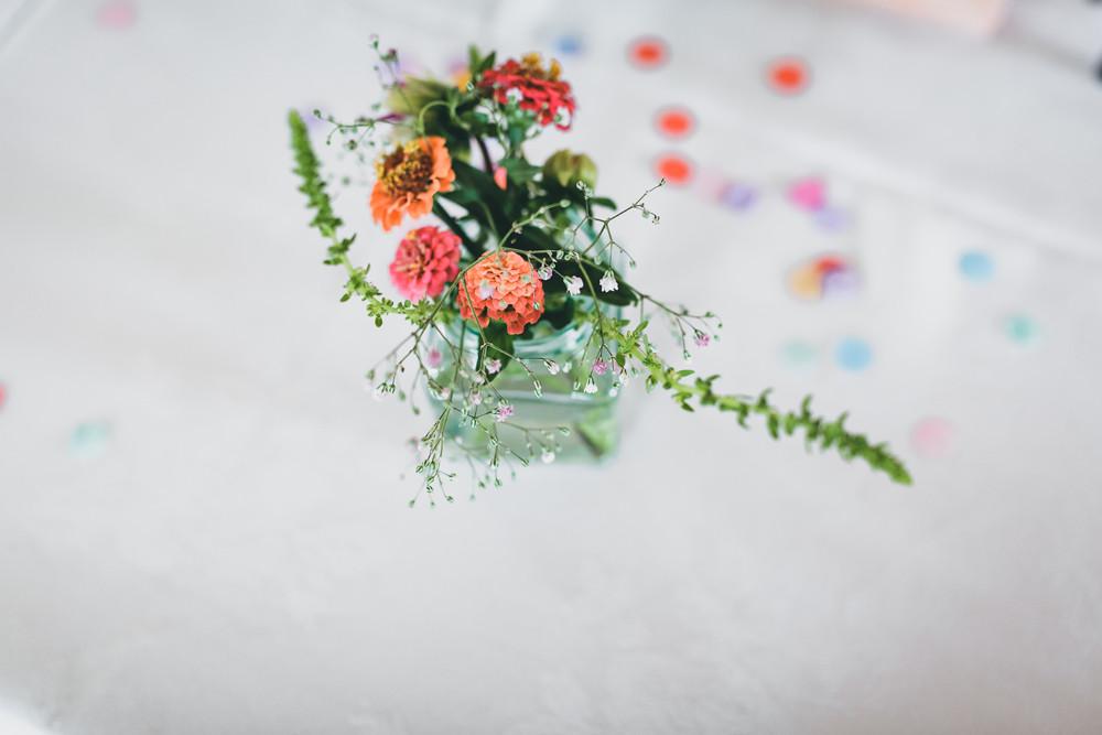 DIY wedding flowers containing south african protea, sunflowers, gypsophila,  hollyhocks, dahlias