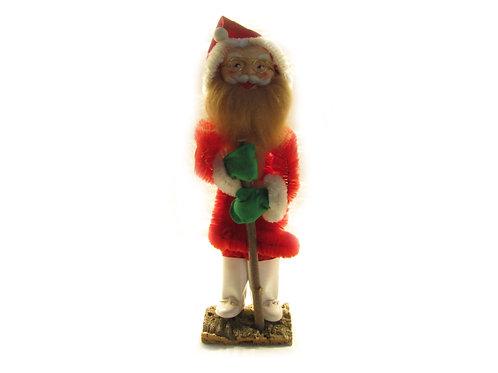 Iso piipunrassi joulutonttu, vihreät lapaset ja silmälasit, valkoiset saappaat