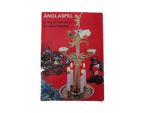Vanha enkelikello, alkuperäispakkauksessa. Punainen pakkaus