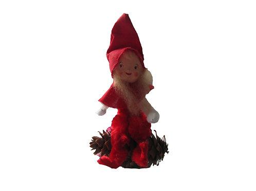 Vanha joulukoriste. Tonttutyttö kävyn päällä. K.A Weiste