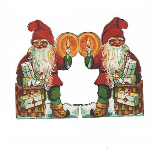 Tontturivi, tonttuhaitari, vanha pöytäkoriste lahjasäkki ja kynttilät