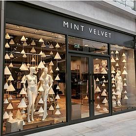 Cone Garlands Window Displays | Visual Mercahdise