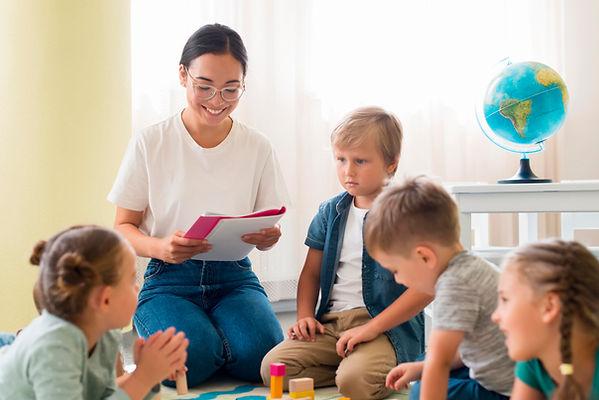 kindergarten-teacher-holding-notebook.jp