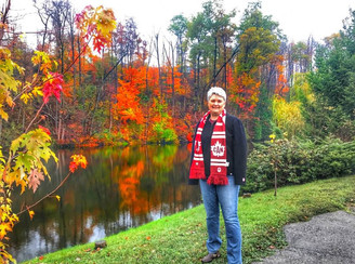 Anthea in front of pond with fall colours.jpg