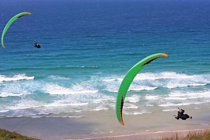 bigstock-Paragliders-92312723